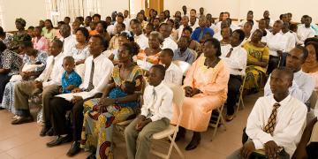 Photo of sacrament meeting via Gospel Media Library.